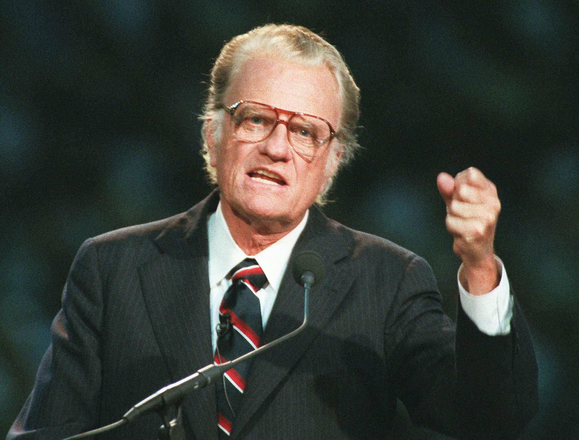 FILE - In this Oct 26, 1994 file photo, Evangelist Billy Graham begins his sermon in Atlanta's Georgia Dome. Graham, who transformed American religious life through his preaching and activism, becoming a counselor to presidents and the most widely heard Christian evangelist in history, has died. | AP