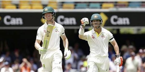 Australia's David Warner, right, and Cameron Bancroft walk off the field after winning the match against England during their Ashes cricket test in Brisbane.|AP