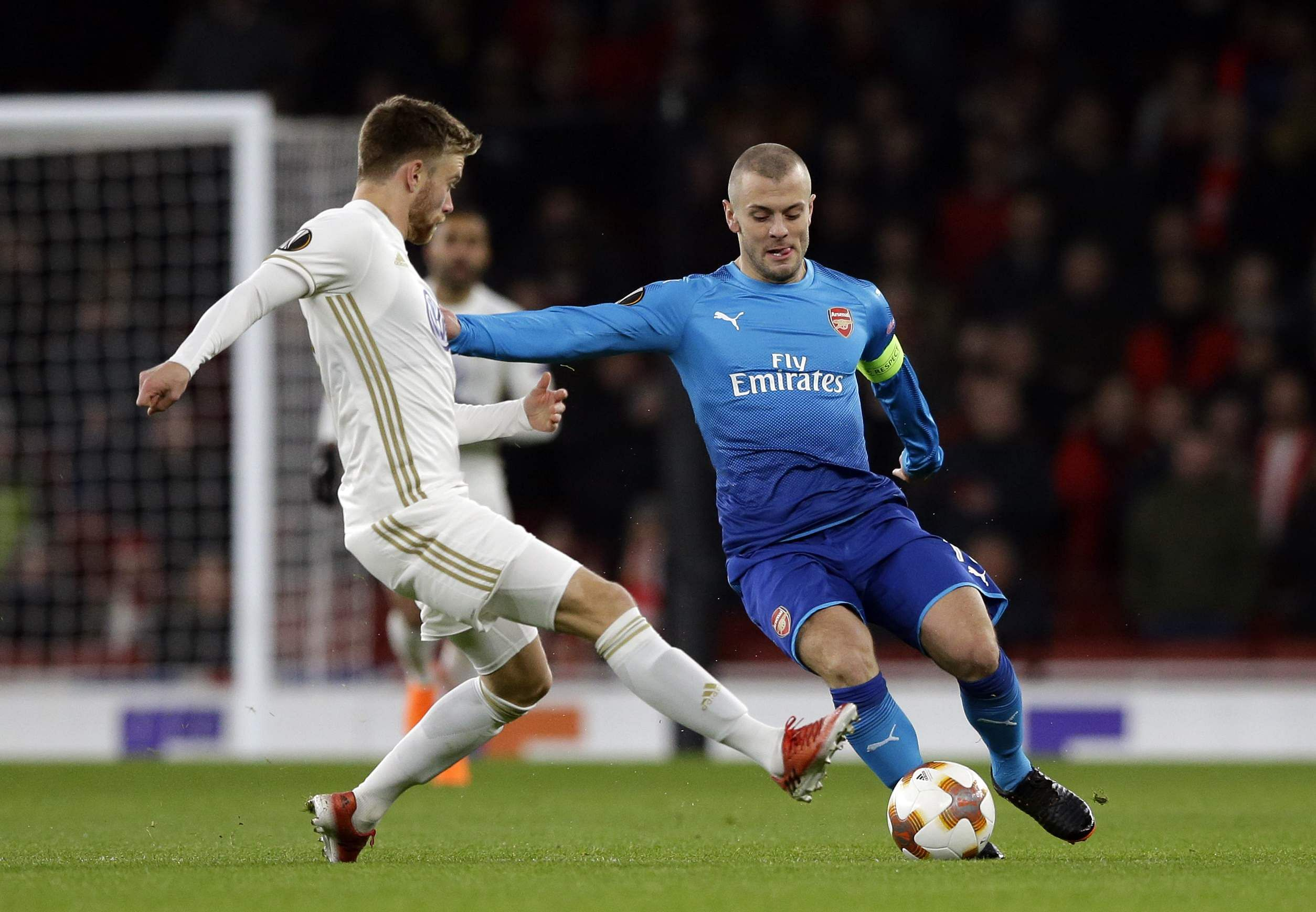 Arsenal's Jack Wilshere, right, battles for the ball with Ostersunds' Dennis Widgren during the Europa League Round of 32, second leg match between Arsenal and Ostersunds FK at the Emirates Stadium in London. (AP)