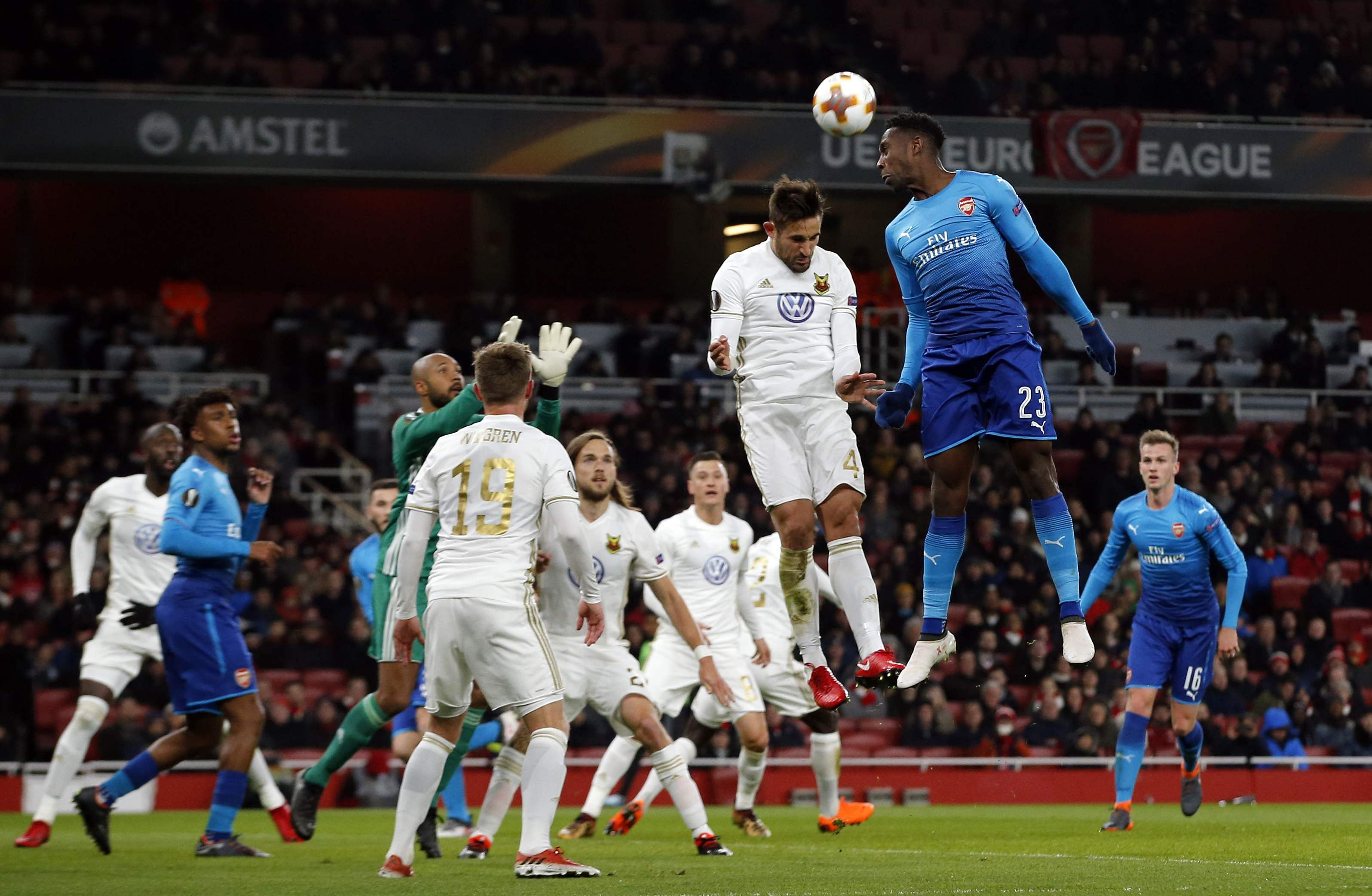 Arsenal's Danny Welbeck, top right, competes for a high ball with Ostersunds' Sotirios Papagiannopoulos. (AP)