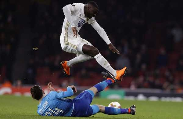 Arsenal's Hector Bellerin, below, dives for the ball against Ostersunds' Ken Sema. (AP)