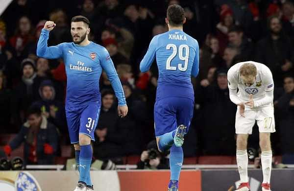 Arsenal's Sead Kolasinac, right, celebrates after scoring his side's lone goal during the Europa League Round of 32, second leg match between Arsenal and Ostersunds FK at the Emirates Stadium in London. (AP)