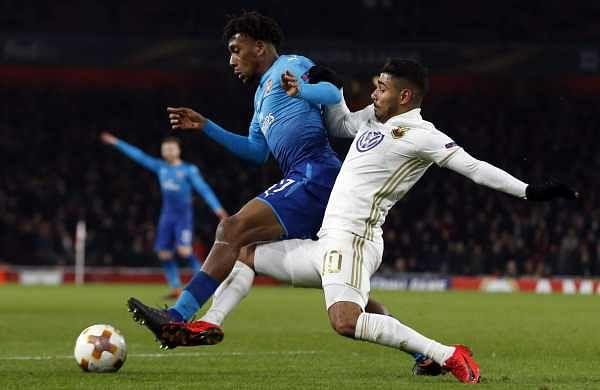 Arsenal's Alex Iwobi, left, and Ostersunds' Hosam Aiesh battle for the ball. (AP)