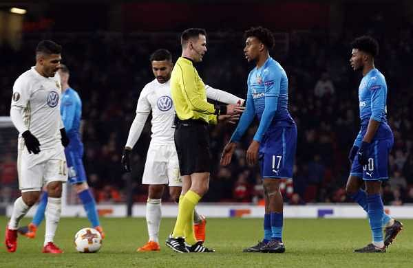 Arsenal's Alex Iwobi, center right, speaks to the referee during the Europa League Round of 32, second leg match between Arsenal and Ostersunds FK at the Emirates Stadium in London. (AP)