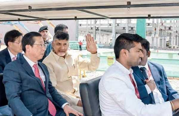 Chief Minister N Chandrababu Naidu and KIA Motors Corporation president Han-Woob Park during the framework installation ceremony at Penukonda in Anantapur district on Thursday | Express