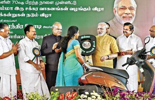Prime Minister Narendra Modi launches the Amma Two-Wheeler Scheme in the presence of Tamil Nadu Governor Banwarilal Purohit (centre) and Chief Minister Edappadi K Palaniswami in Chennai on Saturday | P Jawahar