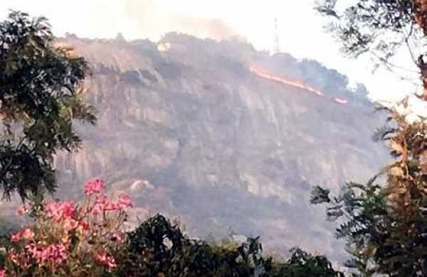 The massive fire spread from the base of the hills near the village of Angatta