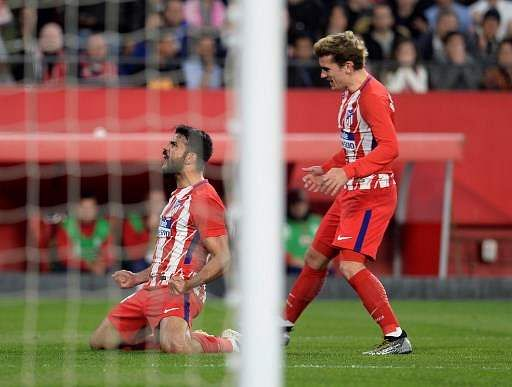 Atletico Madrid strikers Diego Costa and Antoine Griezmann during match against Sevilla | AFP