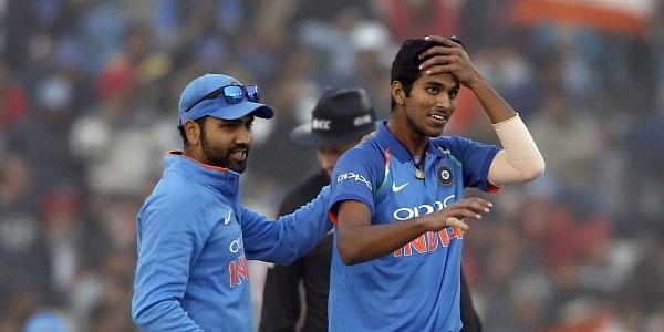 India's captain Rohit Sharma, left, pats teammate Washington Sundar. (AP Photo)