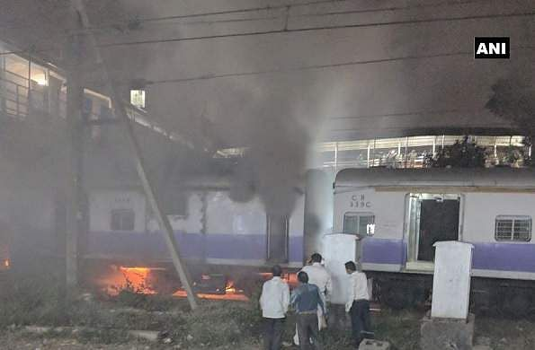 CR services hit, Thane-bound train catches fire