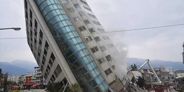 A shallow, magnitude 6.4 earthquake that struck Taiwan's east coast late  Tuesday night caused several buildings to cave in and tilt dangerously .  (AP Photo)
