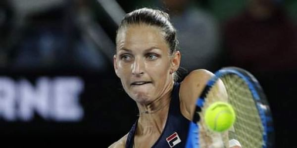 Karolina Pliskova of the Czech Republic hits a backhand return to compatriot Barbora Strycova during their fourth round match at the Australian Open tennis championships in Melbourne. | AP