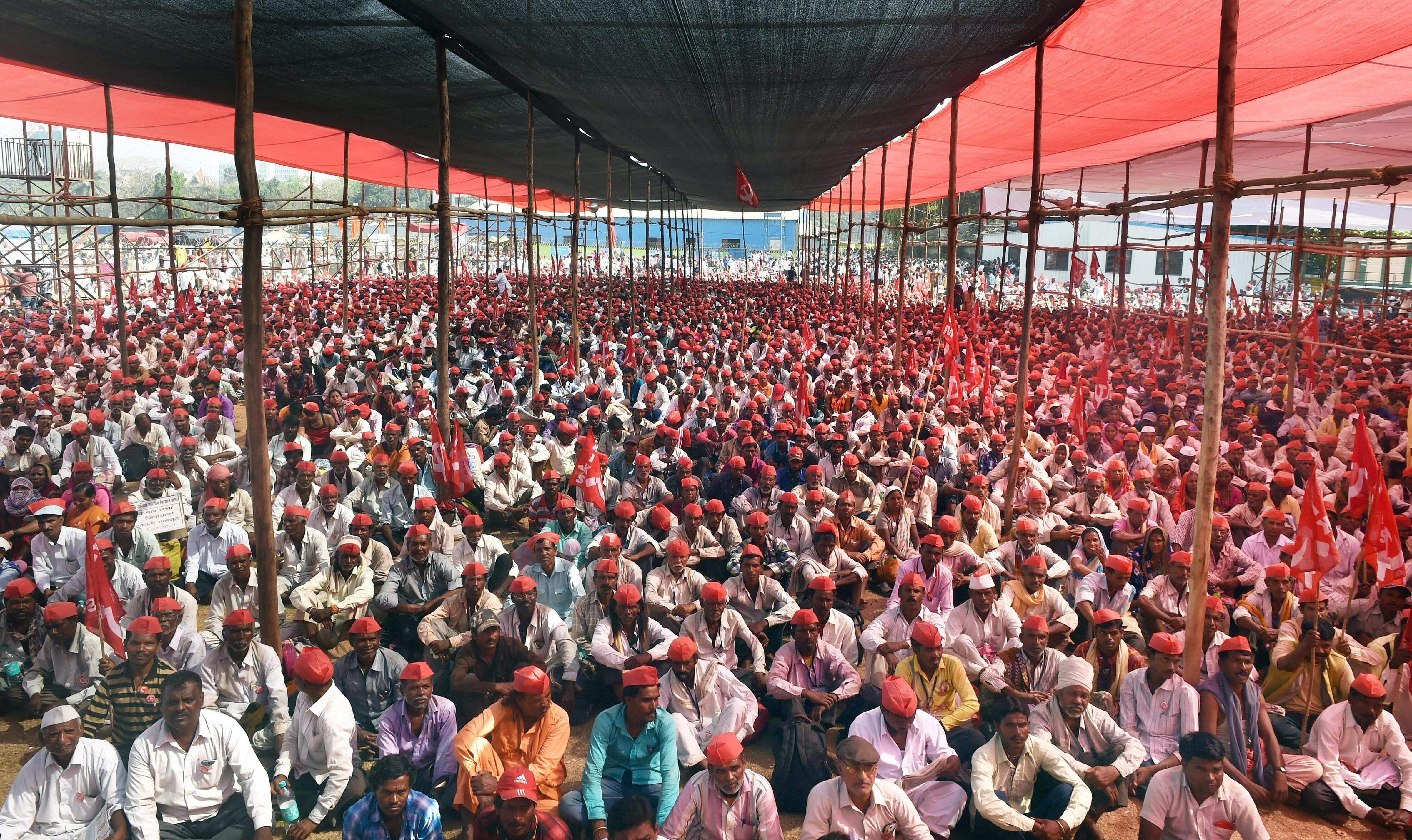 Mumbai Farmers participate in a long march organised by All Indian Kisan Sabha AIKS at Azad Maidan in Mumbai on Monday. (Photo: PTI)