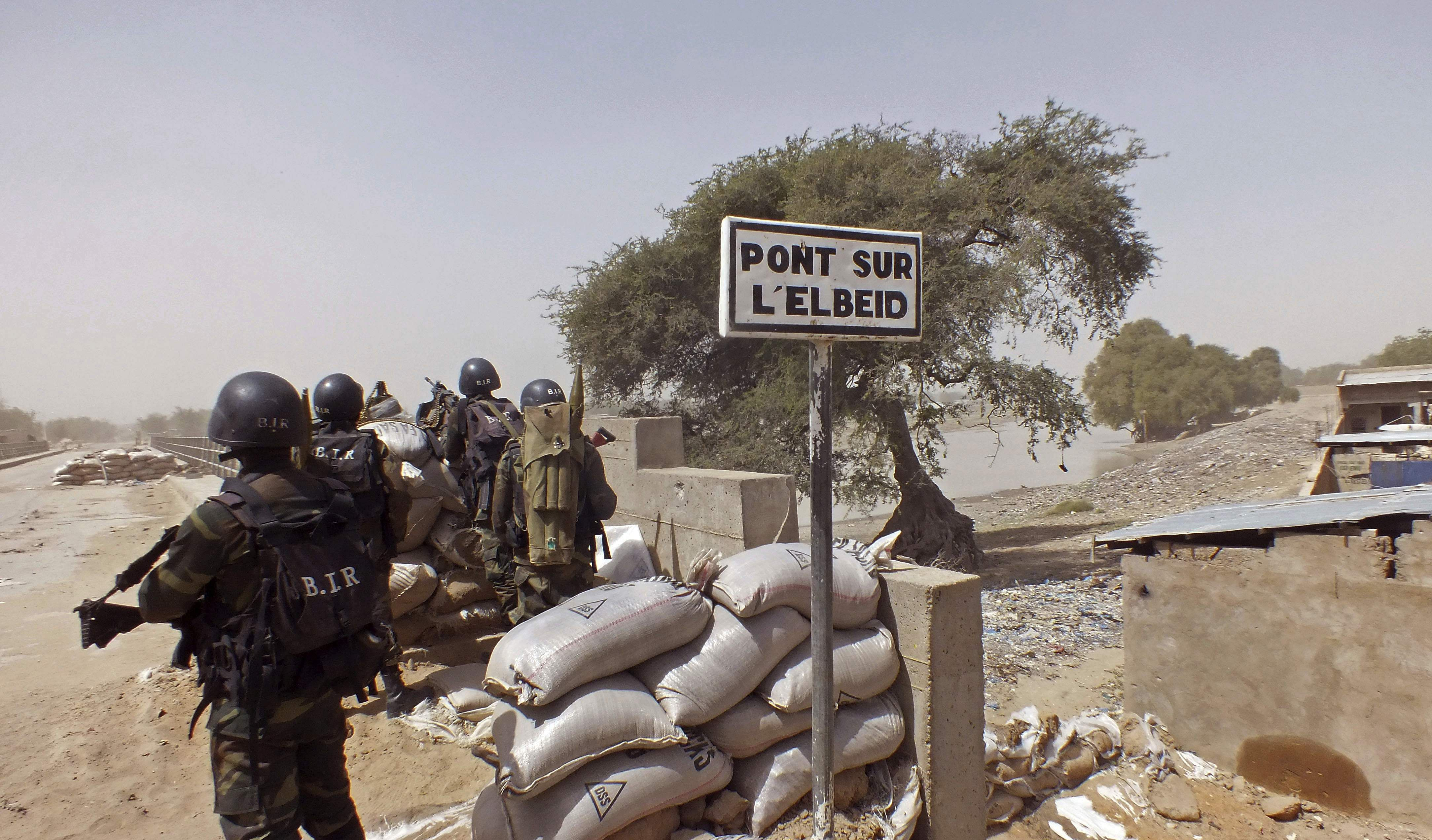 Cameroon soldiers stand guard at a lookout post as they take part in operations against the extremists group Boko Haram, near Elbeid bridge, left rear, that separates northern Cameroon from Nigeria's Borno state (File Photo   AP)