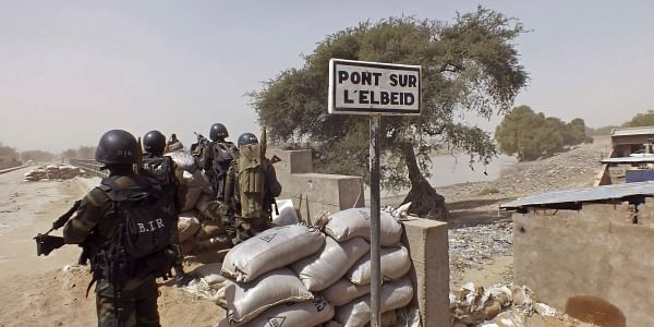 Cameroon soldiers stand guard at a lookout post as they take part in operations against the extremists group Boko Haram, near Elbeid bridge, left rear, that separates northern Cameroon from Nigeria's Borno state (File Photo | AP)