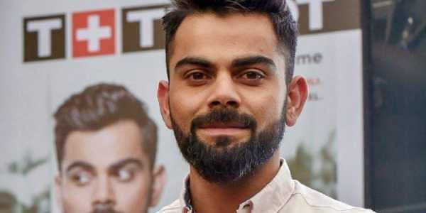 Indian skipper Virat Kohli poses for a photograph during a promotional event in Mumbai. | PTI