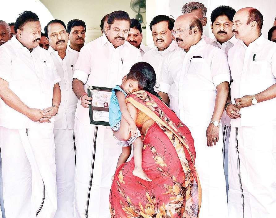 Chief Minister Edappadi K Palaniswami handing over solatium to the family of a missing fisherman, at the Secretariat on Wednesday | p jawahar