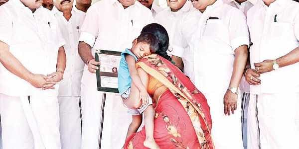 Chief Minister Edappadi K Palaniswami handing over solatium to the family of a missing fisherman, at the Secretariat on Wednesday | p jawahar