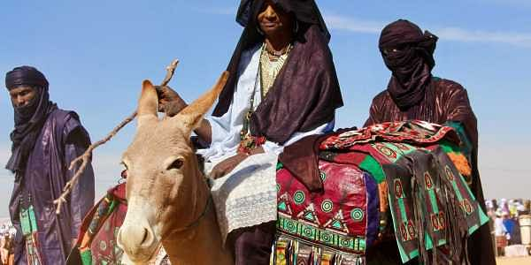 Tuareg men ride on camels during the Niger Tuareg festival in Iferouane, Niger. The festival is one of the many attempts by the people to attract tourists amidst concerns of Islamic extremism concerns failing tourism. (Photo: AP)