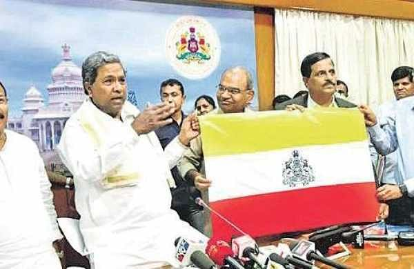 CM Siddaramaiah with the newly-released Karnataka state flag