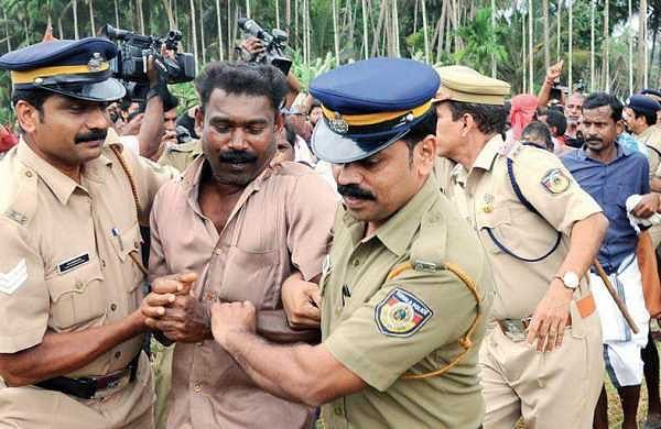 Police forcefully removing the Vayalkkili activists at Keezhattur in Kannur. File | EPS