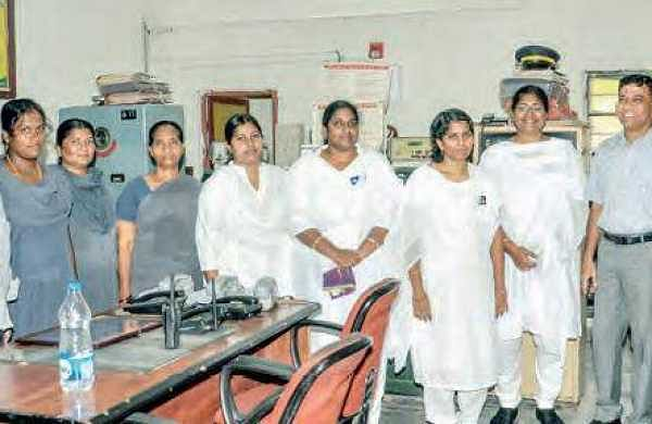 The all-women team to run Ramavarappadu railway station with senior officials during an inspection of the station on Saturday   | Express