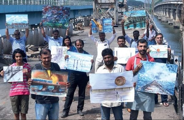 Artists protesting against the dismantling of the old Venduruthy rail bridge, which was constructed during the British rule in India, at Thevara on Sunday | Melton Antony