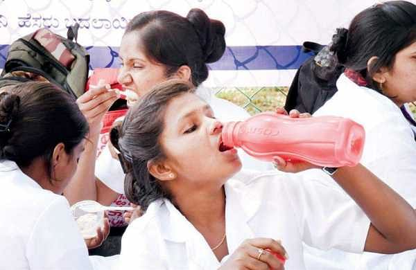 Nurses and lab technicians take a lunch break during the strike at Kidwai Memorial Institute of Oncology | nagaraja gadekal