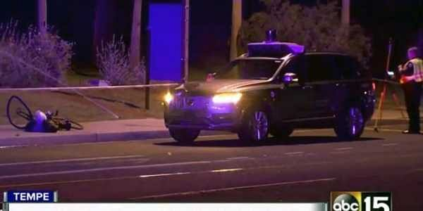 This March 19, 2018 still image taken from video provided by ABC-15, shows investigators at the scene of a fatal accident involving a self driving Uber car on the street in Tempe, Ariz. | AP