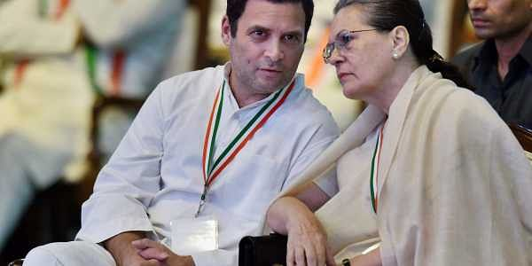 Congress Chairperson Sonia Gandhi and President Rahul Gandhi talk during the 84th Plenary Session of Indian National Congress INC at the Indira Gandhi Stadium in New Delhi on Saturday.