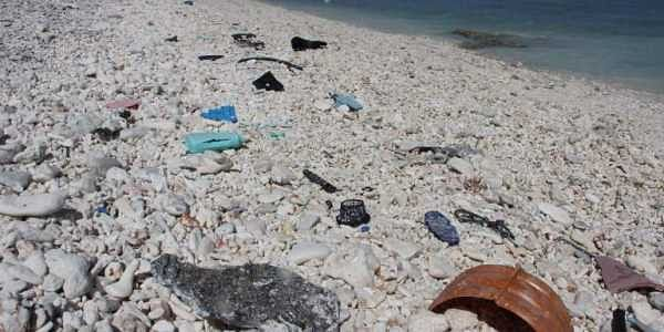 Plastic trash is seen strewn across a beach at Wake Island in the Pacific Ocean.   AFP