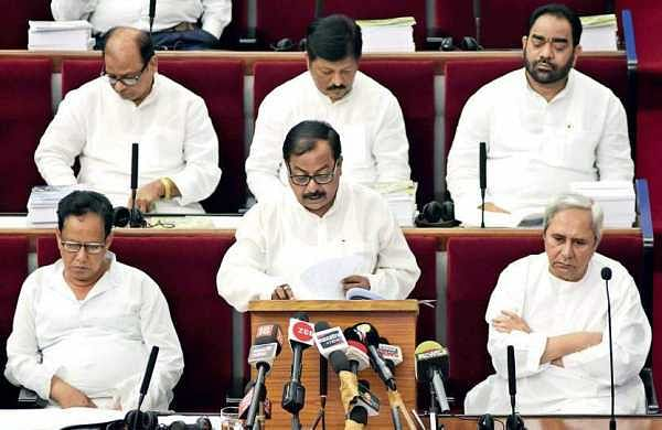 Finance Minister Sashi Bhusan Behera presenting the budget in the Assembly on Friday. Chief Minister Naveen Patnaik and other ministers are also seen | Express