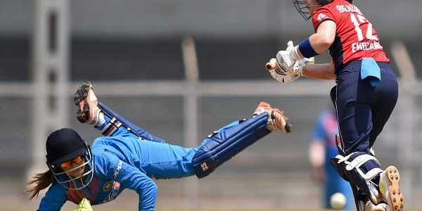 England player Tammy Beaumont plays a shot while India's wicket keeper Taniya Bhatia dives to catch the ball during the Women's T20I Tri-series cricket match played against India at Brabourne stadium in Mumbai on Sunday. | PTI