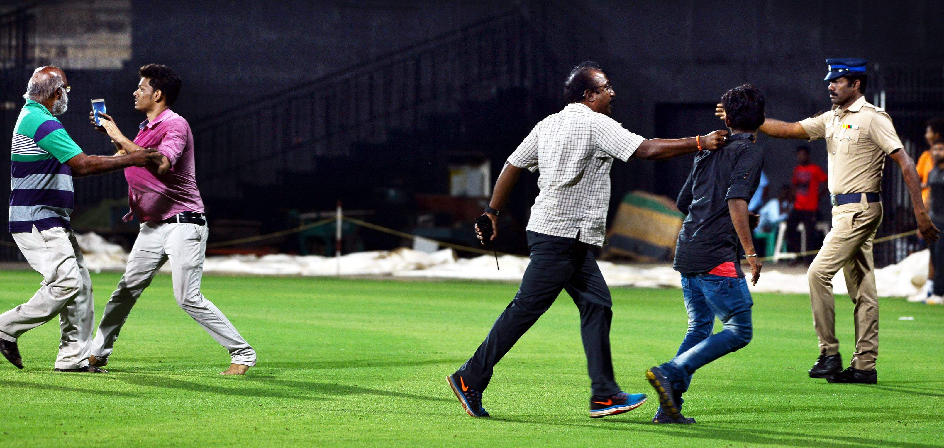 Some over-excited fans even managed to get onto the playing field and had to removed by security personnel. (EPS | D Sampath Kumar)