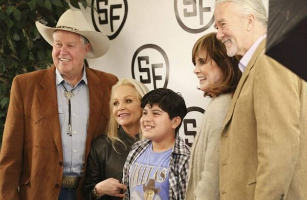 Tyler Hernandez, 12, poses for a photograph with Dallas cast members, from left, Steve Kanaly, Charlene Tilton, Linda Gray and Patrick Duffy during the Dallas 40th Year Reunion at Southfork Ranch in Parker, Texas. | AP