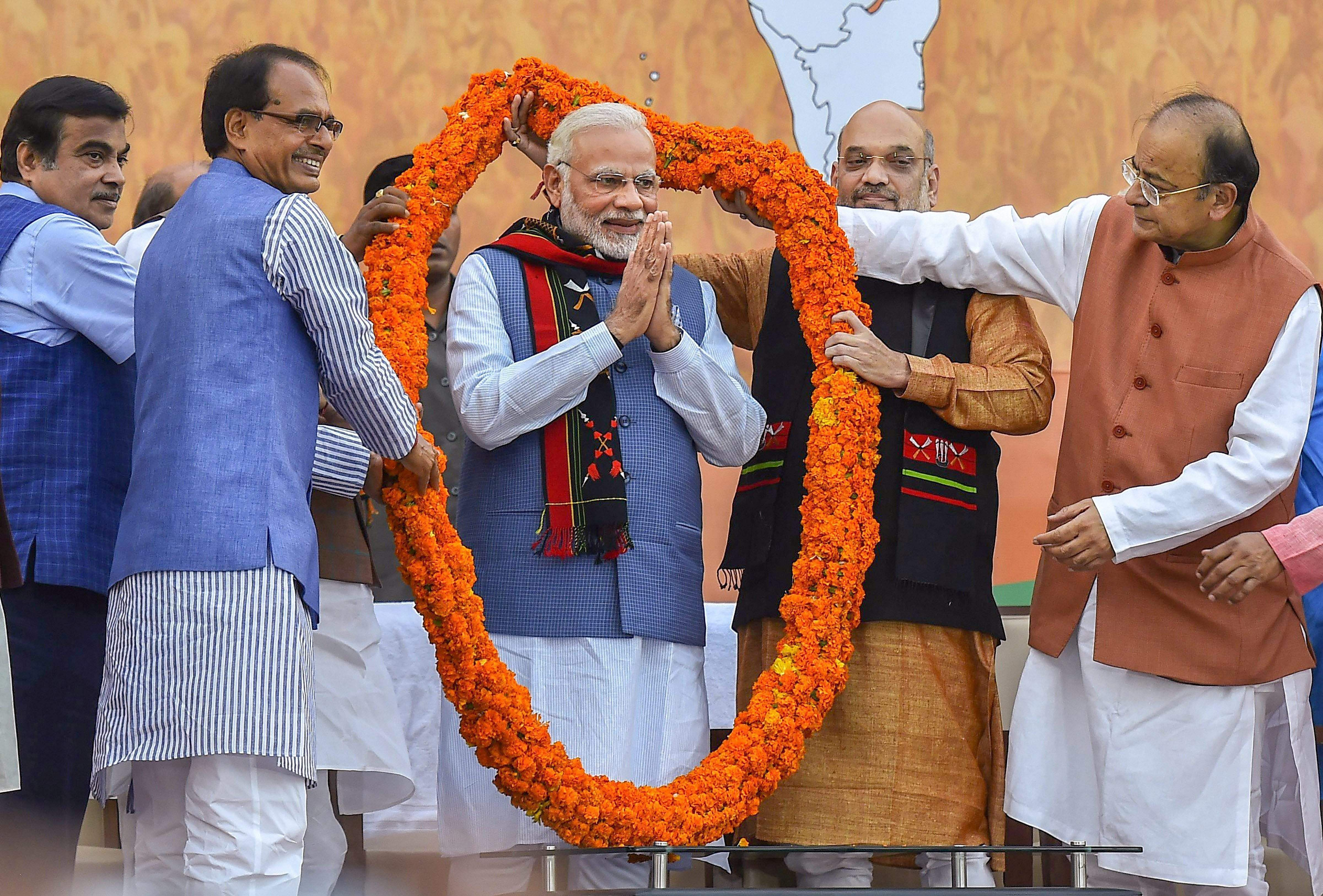 Party leaders felicitate Prime Minister Narendra Modi after their victory in North-East Assembly election at party headquarters in New Delhi. (PTI)
