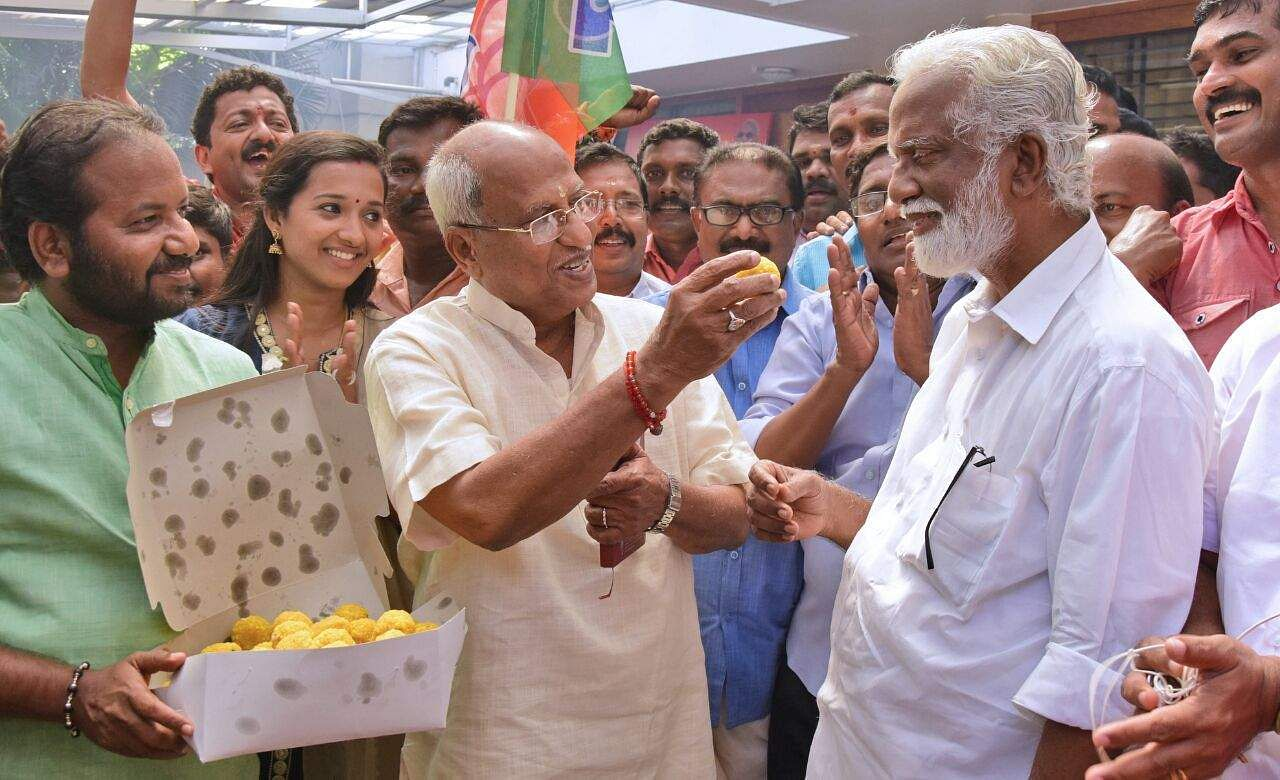 BJP workers led by Kerala State President Kummanam Rajasekharan, and O Rajagopal MLA celebrating Party's electoral victory in Tripura at State Head quarters in Thiruvananthapuram. (EPS | BP Deepu)