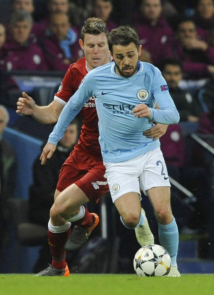 Manchester City's Bernardo Silva, right, vies for the ball with Liverpool's James Milner. (AP)