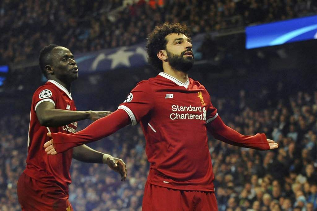 Liverpool's Mohamed Salah, right, celebrates scoring his side's first goal against Manchester City with Liverpool's Sadio Mane. (AP)