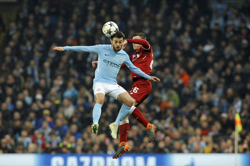 Manchester City's Bernardo Silva, left, competes for the ball with Liverpool's Andrew Robertson during the Champions League quarterfinal second leg match between Manchester City and Liverpool at Etihad stadium in Manchester, England. (AP)