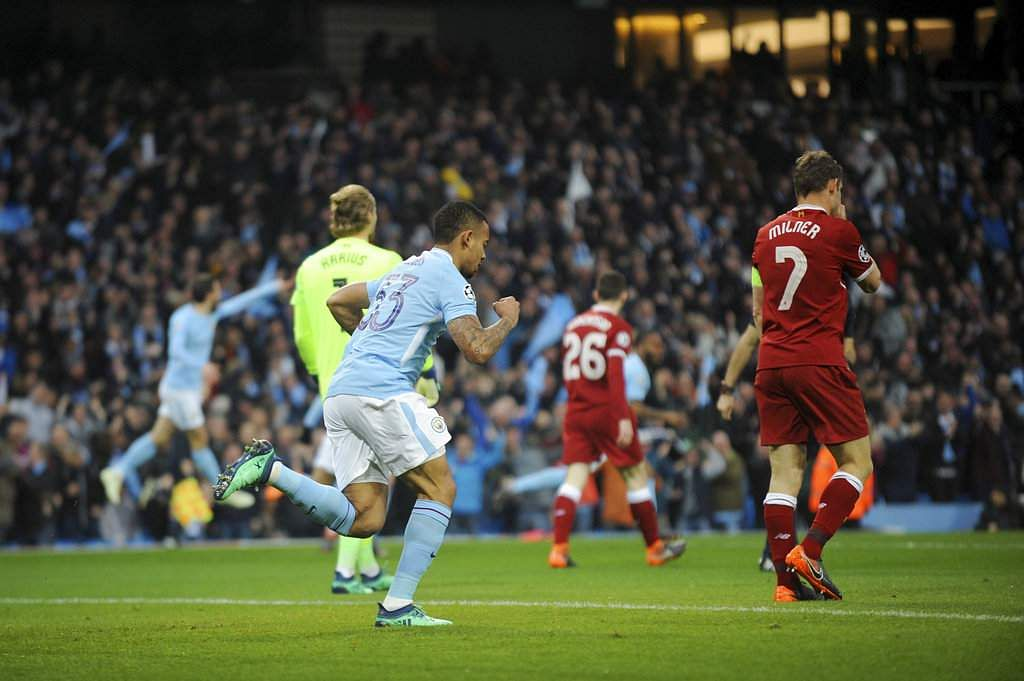 Manchester City's Gabriel Jesus, center, celebrates scoring his side's first goal during the Champions League quarterfinal second leg match between Manchester City and Liverpool. (AP)