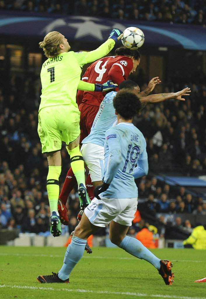 Liverpool goalkeeper Loris Karius punches the ball, after which Manchester City's Leroy Sane, 19, had a goal disallowed. (AP)