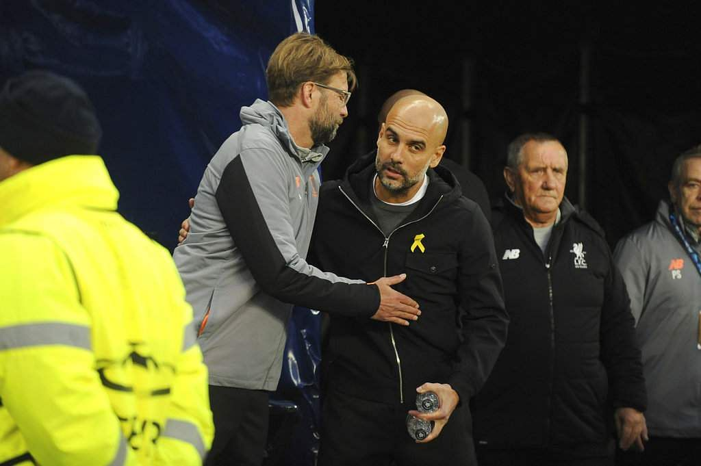 Liverpool manager Juergen Klopp, left, speaks with Manchester City manager Pep Guardiola. (AP)