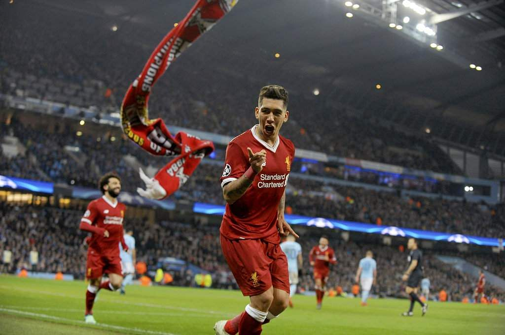 Liverpool's Roberto Firmino celebrates scoring his side's second and decisive goal during the Champions League quarterfinal second leg match between Manchester City and Liverpool. (AP)