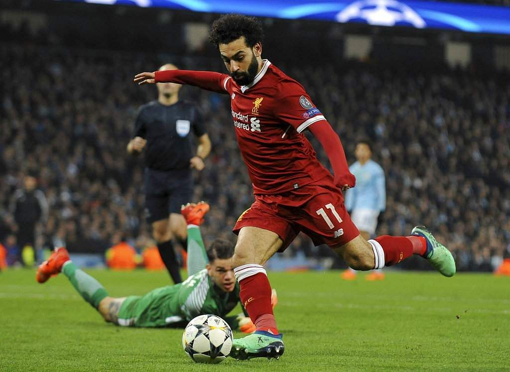 Liverpool's Mohamed Salah scores his side's first goal during the Champions League quarterfinal second leg match between Manchester City and Liverpool. (AP)