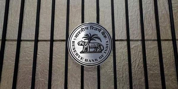 A Reserve Bank of India (RBI) logo is seen at the entrance gate of its headquarters in Mumbai. | REUTERS