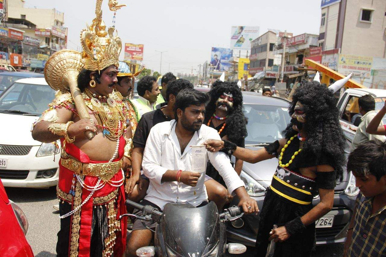 Hyderabad :  Rotary Club of Miyapur  Organised a special Traffic Safety Awareness Drive, where 2 people dressed up like  Yamadharmaraju & Chitragupta stand at traffic junction, approach motorists without helmets, serve notices requesting not to drive without helmet at miyapur in Hyderabad .Express. / K.Sathya keerthi.