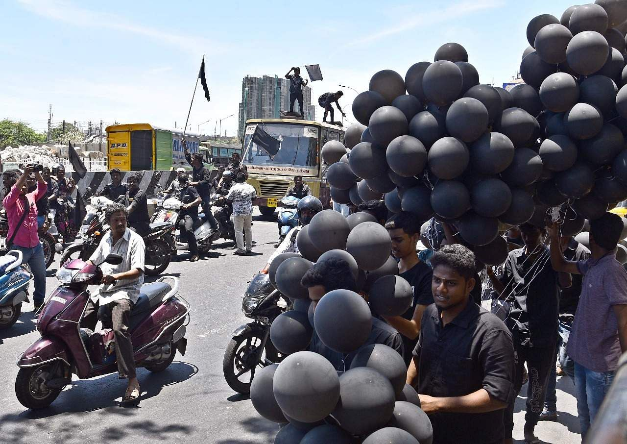 Protesters carrying black flags and black balloons at Saidapet against PM Narendra Modi's visit to Chennai. Express/ Martin Louis