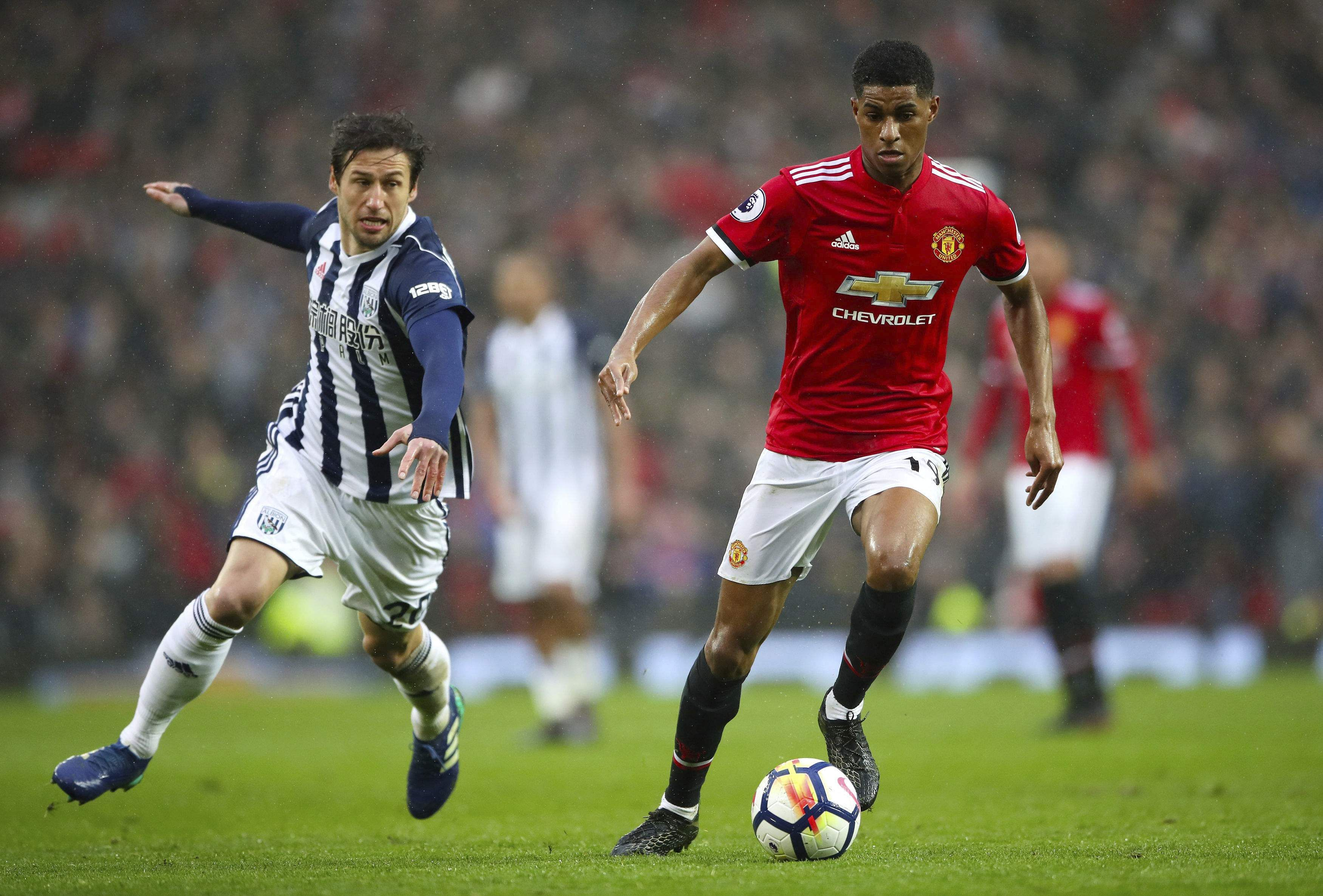 West Bromwich Albion's Grzegorz Krychowiak, left, and Manchester United's Marcus Rashford battle for the ball. (AP)