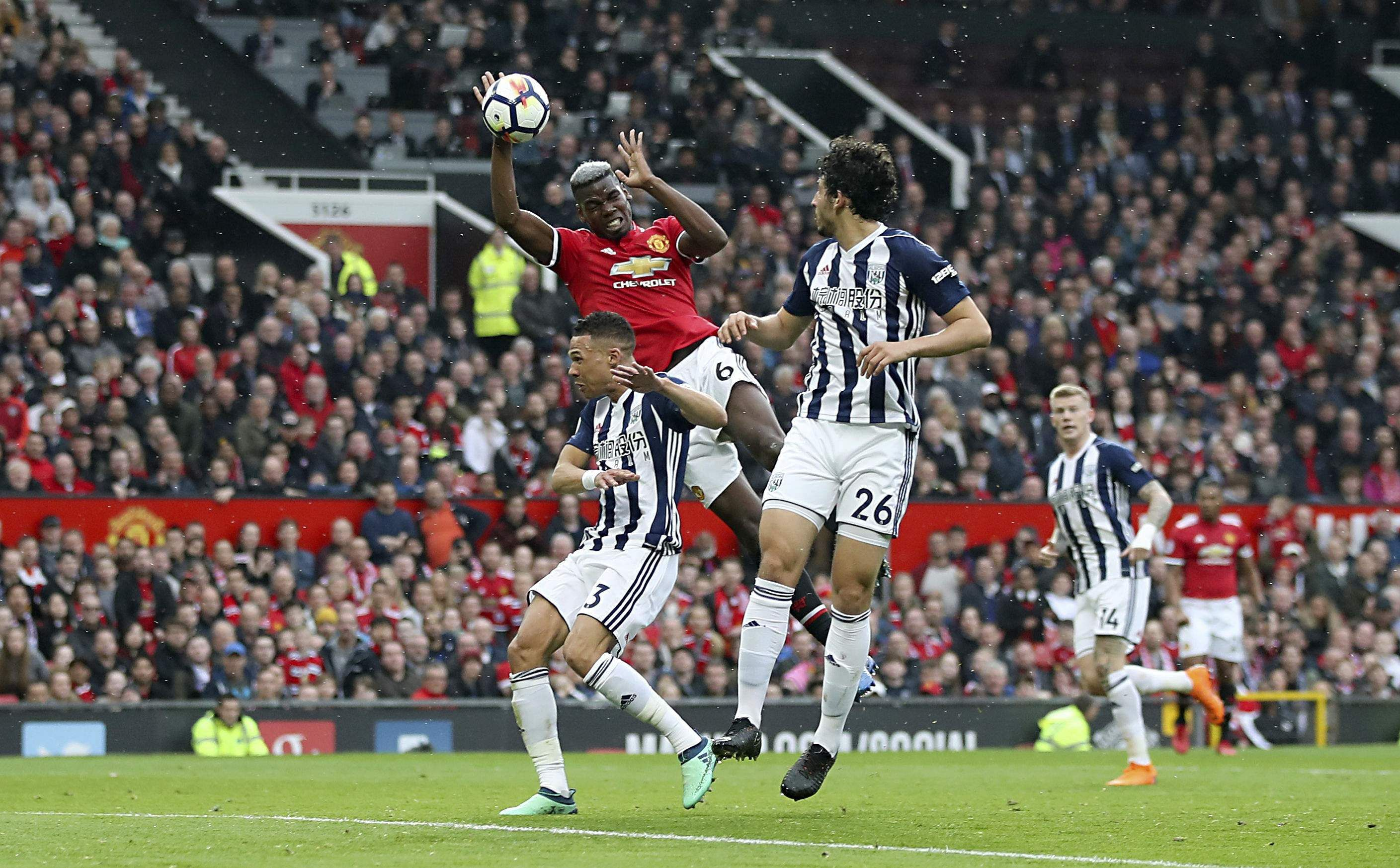 Manchester United's Paul Pogba goes for the ball in the air during the English Premier League match against West Bromwich Albion. (AP)